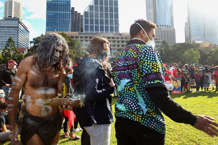 SYDNEY, AUSTRALIA - JULY 05: Aboriginal elders conduct a traditional smoking ceremony during a rally against Aboriginal and Torres Strait Islander deaths in custody in The Domain on July 05, 2020 in Sydney, Australia. Since the Royal Commission into Aboriginal deaths in custody ended in 1991 there have been over 400 deaths. Rallies have been organised across the country in solidarity with the global Black Lives Matter movement. (Photo by Lisa Maree Williams/Getty Images)