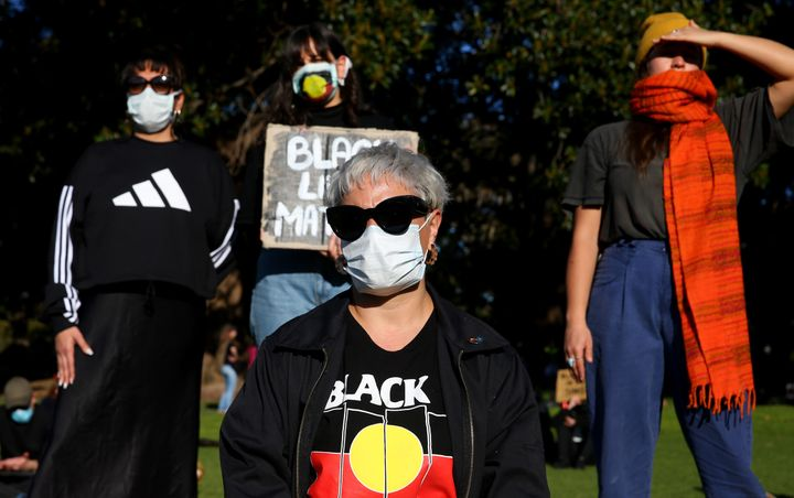 SYDNEY, AUSTRALIA - JULY 05: People look on during a rally against Black Deaths in Custody in The Domain on July 05, 2020 in Sydney, Australia.The rally was organised to protest against Aboriginal and Torres Strait Islander deaths in custody and in solidarity with the global Black Lives Matter movement. (Photo by Don Arnold/Getty Images)