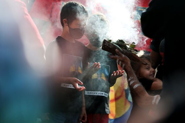 SYDNEY, AUSTRALIA - JULY 05: Young Aboriginal children take part in a traditional smoking ceremony during...