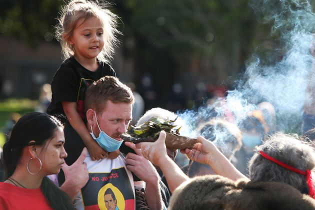 SYDNEY, AUSTRALIA - JULY 05: Aboriginal elders conduct a traditional smoking ceremony during a rally...