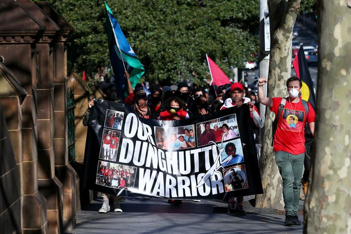 SYDNEY, AUSTRALIA - JULY 05: People march past St Mary's Cathedral during a rally against Black Deaths in Custody in The Domain on July 05, 2020 in Sydney, Australia.The rally was organised to protest against Aboriginal and Torres Strait Islander deaths in custody and in solidarity with the global Black Lives Matter movement. (Photo by Don Arnold/Getty Images)