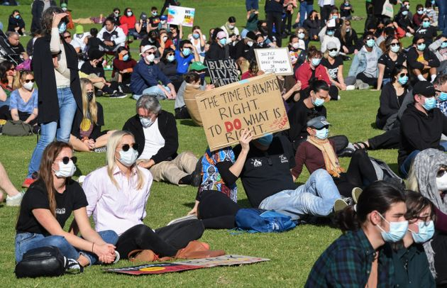 SYDNEY, AUSTRALIA - JULY 05: Protestors wearing face masks gather in the Domain on July 05, 2020 in Sydney,...