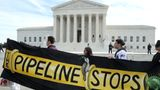 WASHINGTON, DC - FEBRUARY 24: Climate activist groups protest in front of the U.S. Supreme Court as oral arguments are heard in U.S. Forest Service and Atlantic Coast Pipeline, LLC v. Cowpasture River Assn. case, on February 24, 2020 in Washington, DC. The high court is hearing cases on Dominion Energy's proposed $7.5 billion Atlantic Coast Pipeline crossing the Appalachian Trail. (Photo by Mark Wilson/Getty Images)