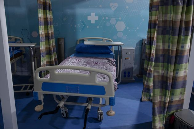 Hospital beds are prepared to receive COVID-19 patients at Ain Shams University Field Hospital in Cairo,...