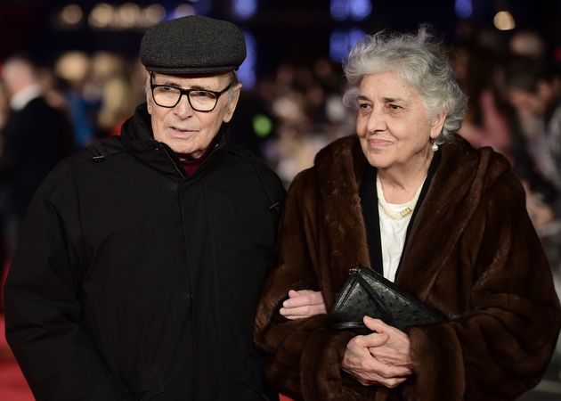 Italian composer Ennio Morricone poses with his wife Maria Travia on the red carpet of the European premiere...