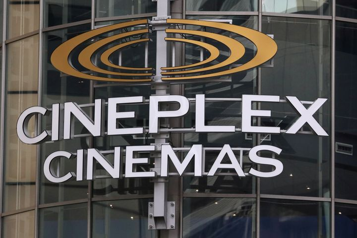 """A Cineplex movie theatre sign looms over Yonge Street in Toronto on March 16, 2020. Analysts say they expect Cineworld to buy Cineplex on """"revised terms"""" after the former backed out of a takeover deal."""