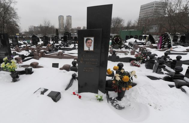 The snow clad grave of Russian lawyer Sergei Magnitsky at the Preobrazhenskoye cemetery in