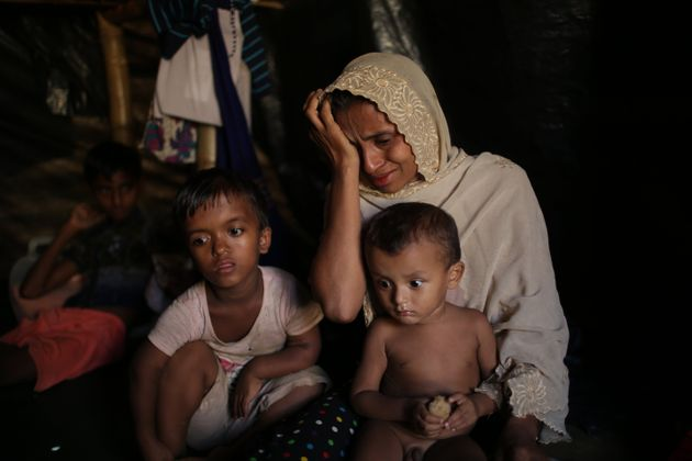 Jamila Begum, 35, cries when talking about how members of Myanmar's armed forces killed her son and husband...