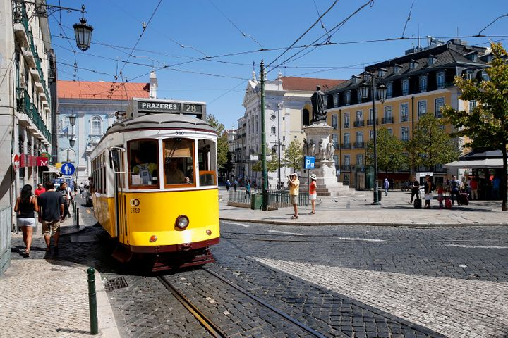 One of Lisbon's famous yellow trams, an attraction for the 4.5 million tourists who have been visiting the city each year.