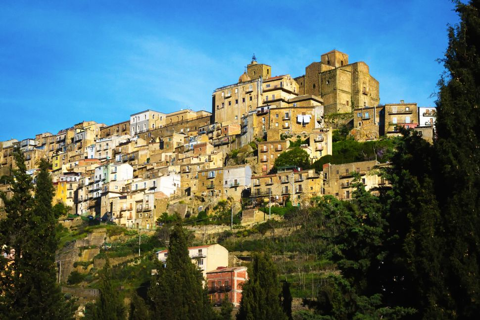 Panoramic view of the beautiful hill town of Troina, Sicily, in Enna Province. Copy space available in the bright blue sky.
