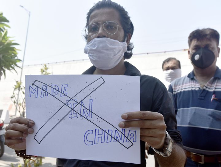A protester holds up a poster as a group calls for boycott of Chinese manufactured products at Laxmi Nagar on June 18, 2020 in New Delhi, India.