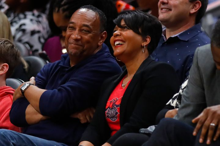 Atlanta Mayor Keisha Lance Bottoms and her husband at an NBA game in February. Bottoms said they both tested positive for cor