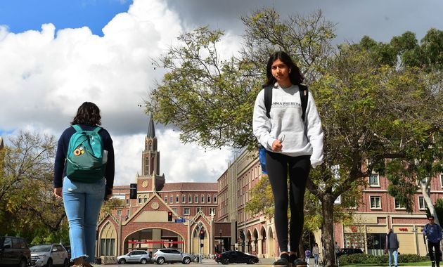 Students walk on campus at the University of Southern California (USC) in Los Angeles on March 11,
