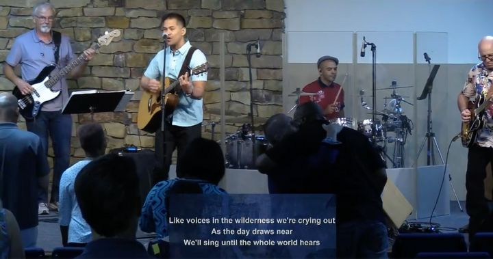 Pastor Ron Arbaugh can be spotted hugging an attendee in this screenshot from a June 21 service atCalvary Chapel of San