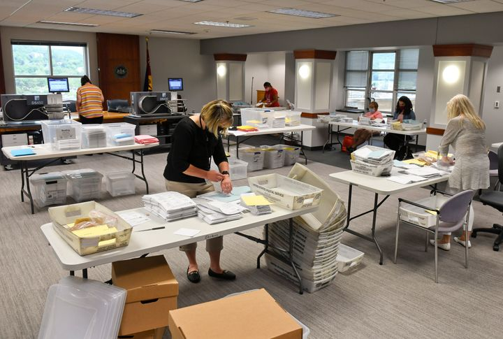 Election workers in Reading, Pennsylvania, open mail-in and absentee ballots on June 3.