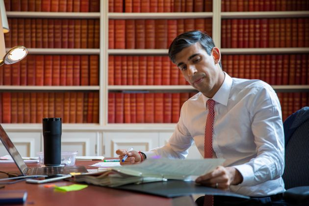 Undated handout photo issued by HM Treasury showing Chancellor of the Exchequer Rishi Sunak preparing the Economic Update he will present to Parliament tomorrow.