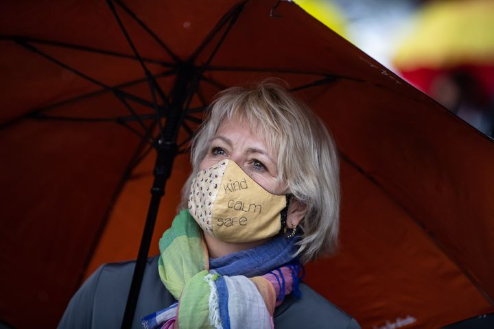 """British Columbia provincial health officer Dr. Bonnie Henry wears a face mask as she views the """"Murals of Gratitude"""" exhibition in Vancouver on July 3, 2020."""