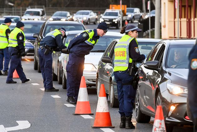 Police in the southern New South Wales (NSW) border city of Albury check cars crossing the state border...