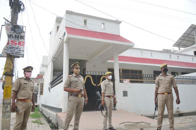 Police officials stand guard outside gangster Vikas Dubey's house at Krishna Nagar on July 3, 2020 in