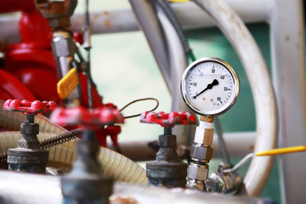 Pressure gauge using measure the pressure in production process. Worker or Operator monitoring oil and...