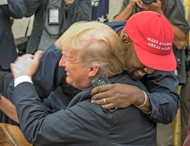 Kanye West and Donald Trump embracing in the Oval