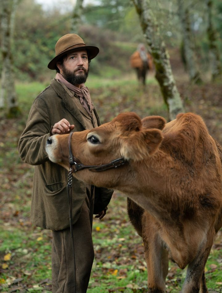 "Eve the cow (seen here with John Magaro) makes her screen debut in ""First Cow."""