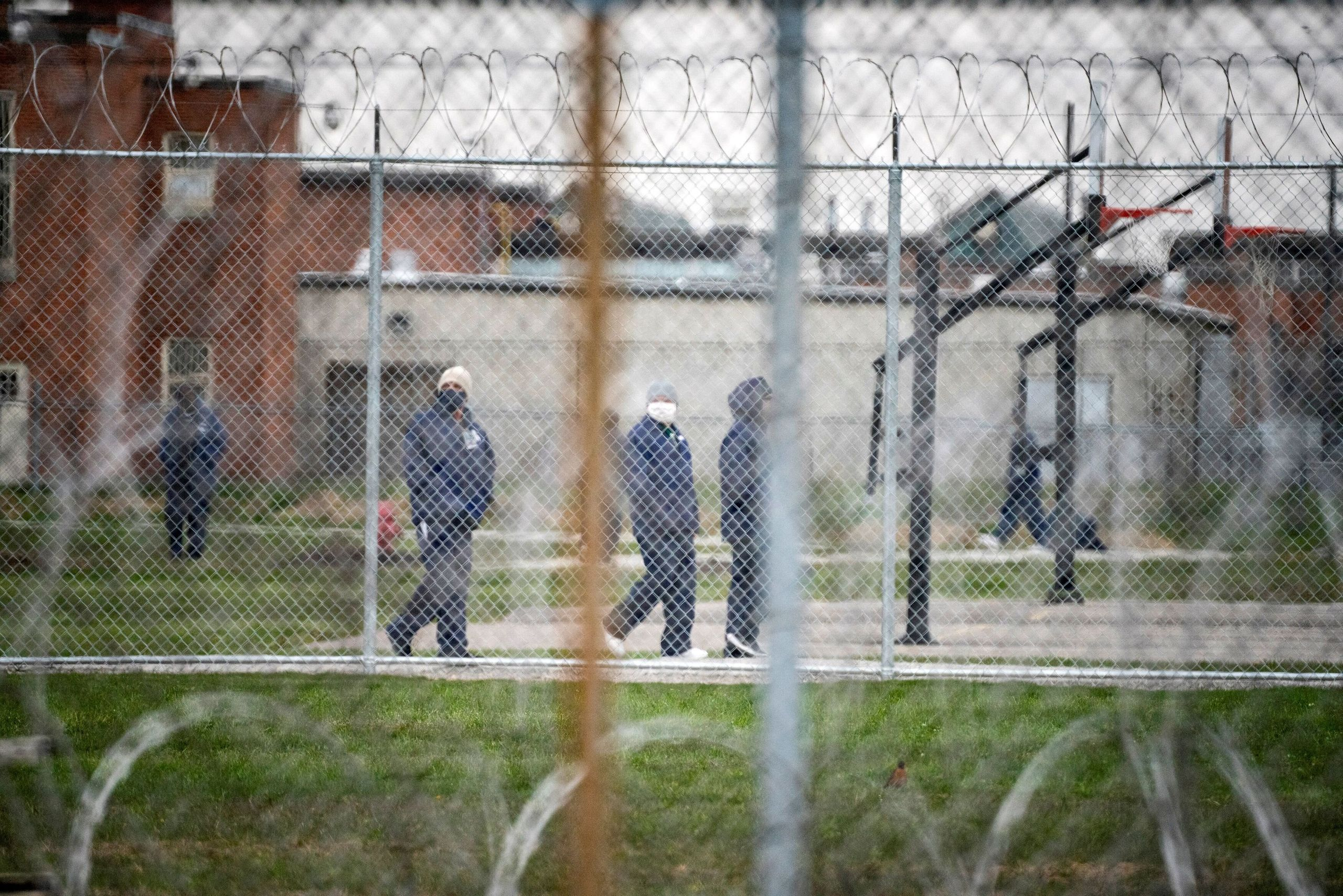 People walk in the yard at Marion Correctional Institution on April 22, just after the prison completed mass testing for the
