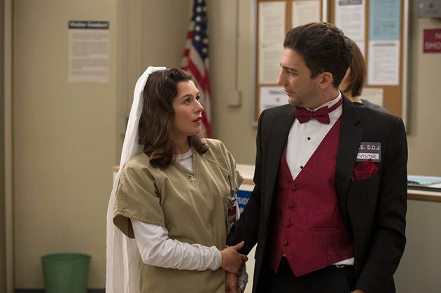 Magaro with Yael Stone in an episode of