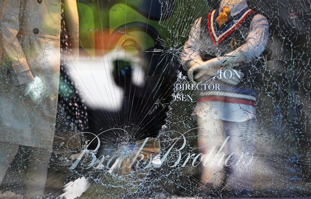 BOSTON, MA - MAY 31: Broken window at Brooks Brothers on Newbury street in Boston as people begin cleaning...