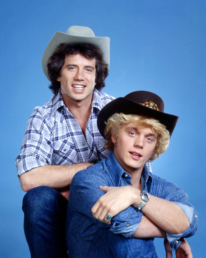 "Tom Wopat (left) and John Schneider in a promotional portrait for ""The Dukes of Hazzard."" On the show, they drove a customize"
