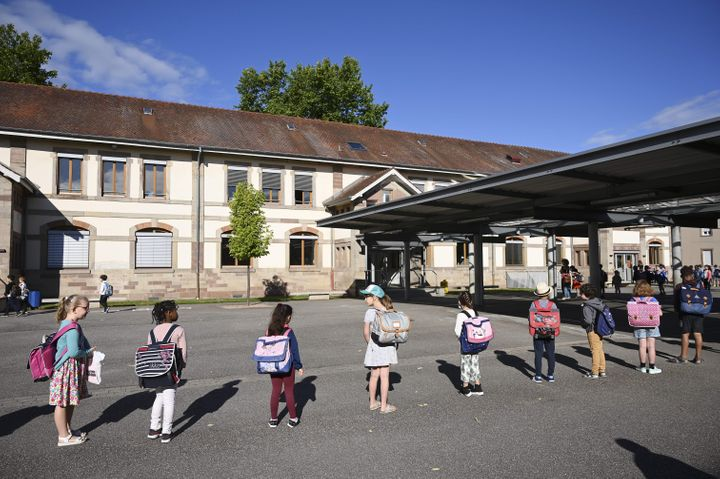Children line up to enter their classrooms at an elementary school in Strasbourg,  France. Primary and middle schools in the country reopened on June 22.