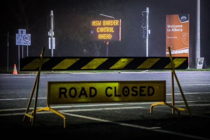 Road signs are displayed near a police checkpoint on July 8, 2020 in Albury, Australia.  (Photo by David Gray/Getty Images)