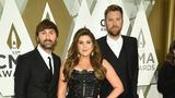 "FILE - This Nov. 13, 2019 file photo shows Dave Haywood, from left, Hillary Scott, and Charles Kelley of Lady Antebellum at the 53rd annual CMA Awards in Nashville, Tenn. The group is changing their name to Lady A, saying they are regretful for not taking into consideration the word's associations with slavery. They said in recent weeks, their eyes have been opened to ""blindspots we didn't even know existed"" and ""the injustices, inequality and biases black women and men have always faced."" (Photo by Evan Agostini/Invision/AP, File)"