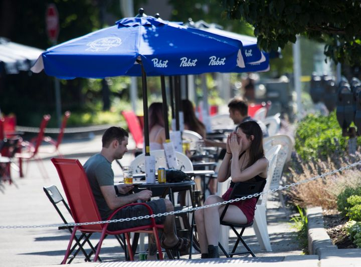 Restaurants, bars and other food and drink establishments are open for dining in outdoor areas, like patios, curbside, parking lots and adjacent properties in the places of Ontario cleared to enter Phase 2 of reopening amid the COVID-19 pandemic in Hamilton, Ont. on July 7, 2020.