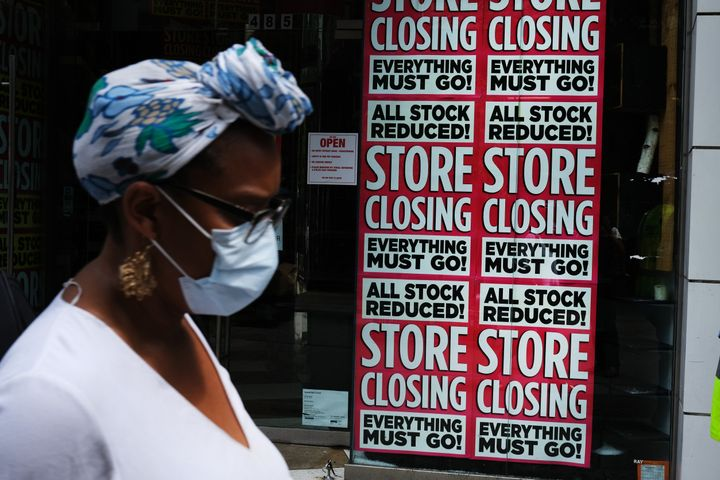 A store advertises a sale on July 7 in Brooklyn, New York. The economic fallout from the coronavirus pandemic has been dire.