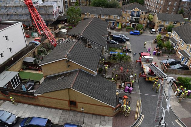 The scene in Bow where a 20-metre crane collapsed on to a property leaving people trapped inside, in...