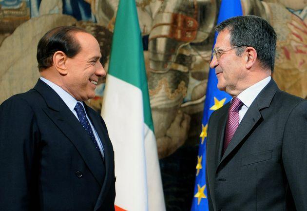 Outgoing Italian Prime Minister Romano Prodi (R) smiles beside new Prime Minister Silvio Berlusconi during...