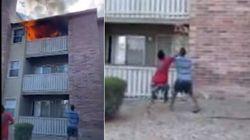 Lancia il figlio di 3 anni dal balcone per salvarlo da un incendio: preso al volo