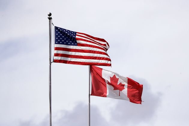 U.S. and Canadian flags fly atop the Peace Arch in B.C. at the Canada-U.S. border on May 17,
