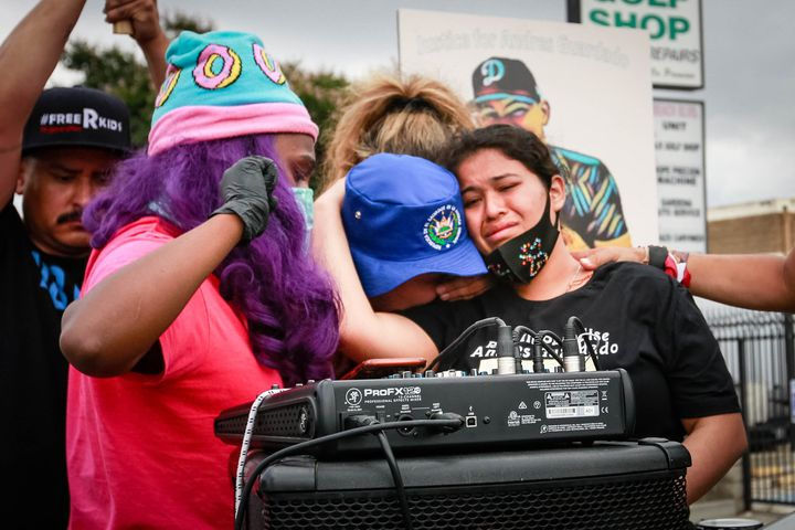 Jennifer Guardado, sister of Andres Guardado, and other relatives of speak at a rally seeking justice for the 18-year-old on