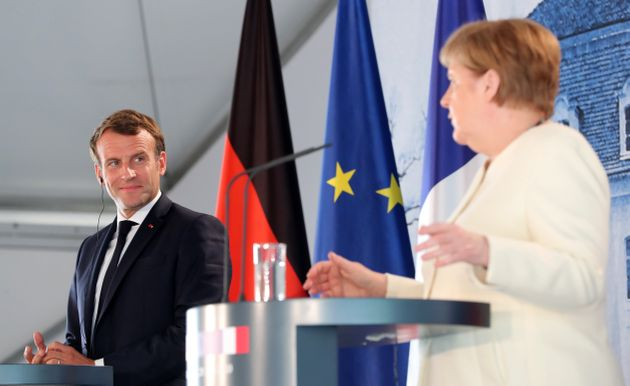 German Chancellor Angela Merkel and French President Emmanuel Macron give a press conference on June...
