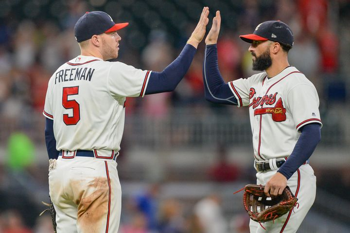 After Atlanta Braves first baseman Freddie Freeman (left) tested positive for COVID-19, rightfielder Nick Markakis (right) de