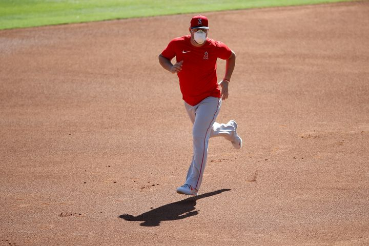 The Los Angeles Angels and at least three other Major League Baseball teams temporarily halted summer camp preparations for t