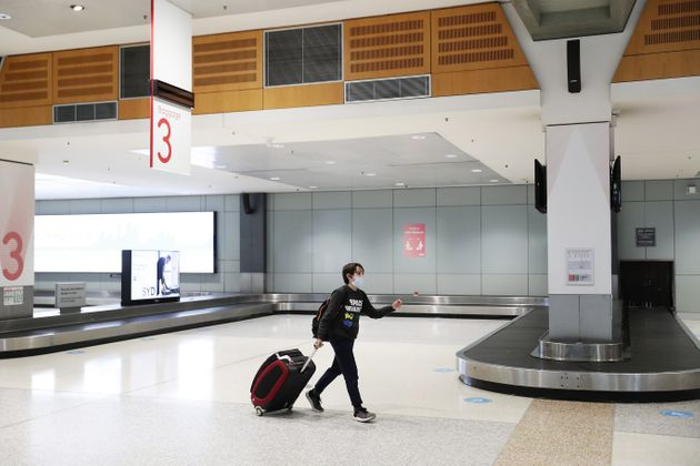 A passenger, off a Melbourne to Sydney flight, arrives at Sydney domestic airport on July 08, 2020...