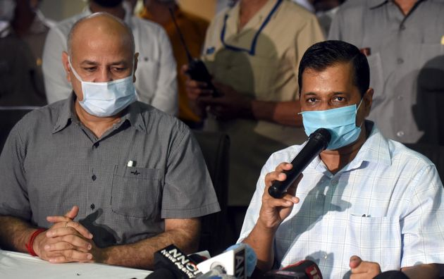 Delhi Chief Minister Arvind Kejriwal and Deputy CM Manish Sisodia address the media during a visit to...