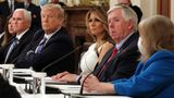 WASHINGTON, DC - JULY 07: U.S. President Donald Trump, flanked first lady Melania Trump by Vice President Mike Pence (L) participate in an event with students, teachers and administrators about how to safely re-open schools during the novel coronavirus pandemic in the East Room at the White House July 07, 2020 in Washington, DC. As the number of COVID-19 cases surge across southern states like Florida, Texas, Louisiana, South Carolina and Arizona, Trump joined with guests from across the country to discuss how to responsibly return to the classroom. (Photo by Chip Somodevilla/Getty Images)