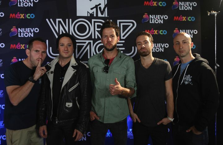 Chuck Comeau, David Desrosiers, Pierre Bouvier, Sebastien Lefebvre, and Jeff Stinco of Simple Plan attend a press conference during the MTV World Stage at Arena Monterrey on October 3, 2013 in Mexico.