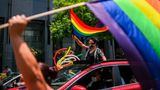 Revelers flutter rainbow flags from cars during the celebration of gay pride in Mexico City, on June 27, 2020. - Activists substituted on Saturday the annual Gay Pride parade for a digital march due to confinement measures against the spread of the new coronavirus, and demanded justice for hate crimes. (Photo by PEDRO PARDO / AFP) (Photo by PEDRO PARDO/AFP via Getty Images)