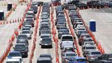 MIAMI BEACH, FL - JULY 10: Cars wait in line at the Coronavirus (COVID-19) drive up testing site set up at the Miami Beach Convention Center as Florida shatters records with over 11K new COVID-19 cases in single day on July 10, 2020 in Miami Beach, Florida. Credit: mpi04/MediaPunch /IPX