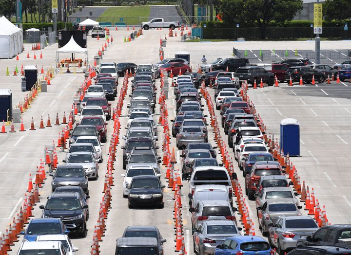 Cars wait in line at the coronavirus (COVID-19) drive up testing site set up at the Miami Beach Convention Center as Florida